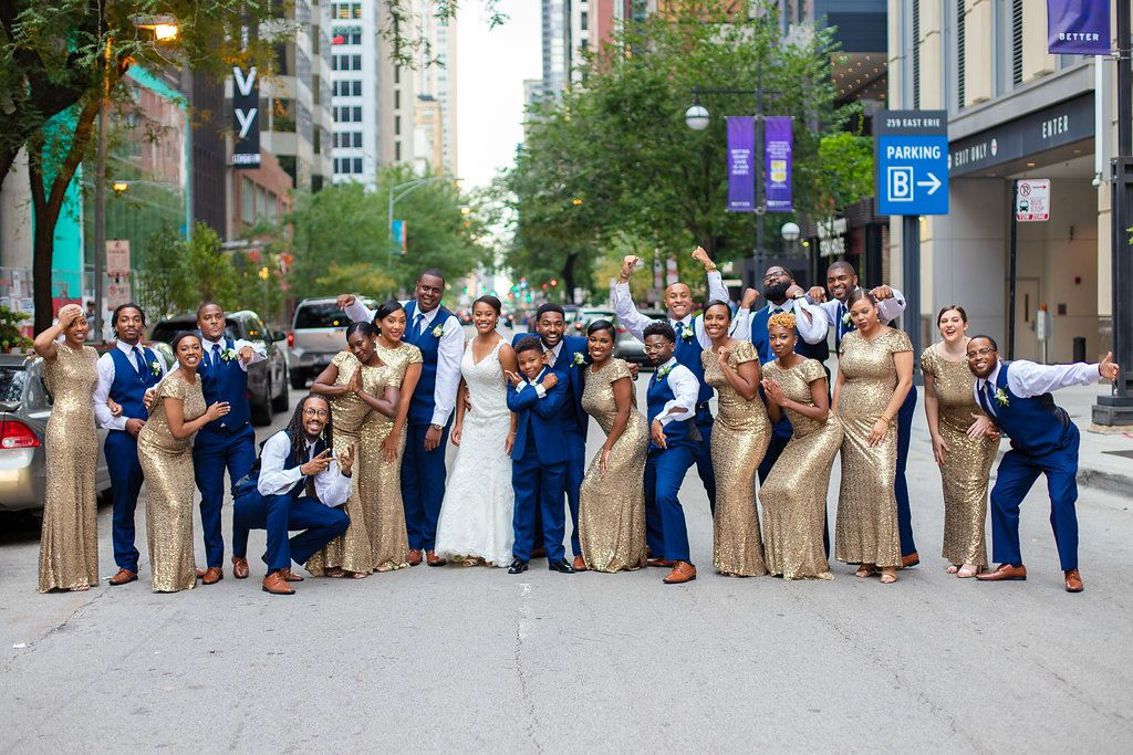 Chicago Wedding Planner SouthWind Events bridal party wedding party in blue suits and gold sequin dresses. Photograph taken by J Lauryn Photography.