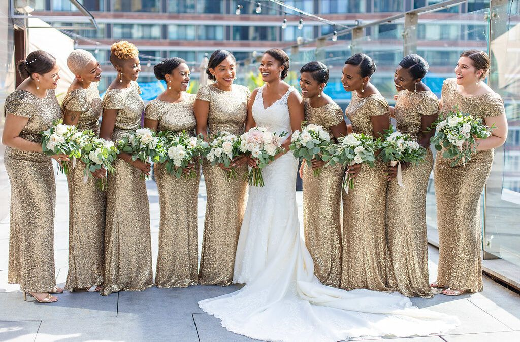 Chicago Wedding Planner SouthWind Events bride and bridesmaids in gold sequin gowns. Photograph taken by J Lauryn Photography on the rooftop of the Ivy Hotel Chicago.